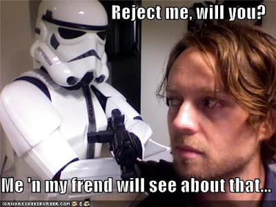 Darren Hayes, a blonde bestubbled man, looks over his shoulder apprehensively at a Star Wars Stormtrooper
