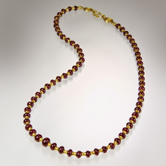 http://quadrumgallery.com/jewelry/product/flared-tube-ruby-necklace