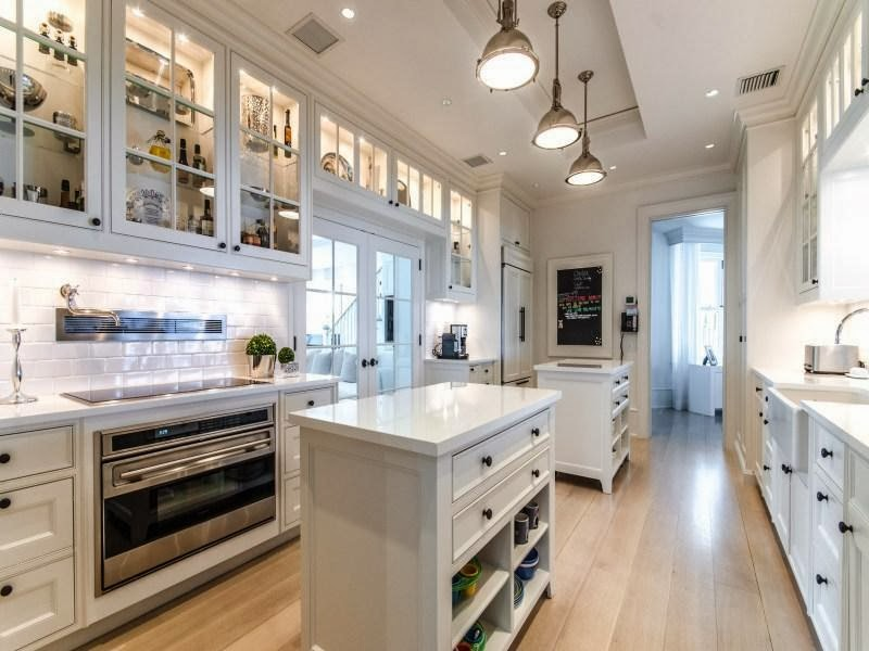 White kitchen in Custom built celebrity home for Celine Dion