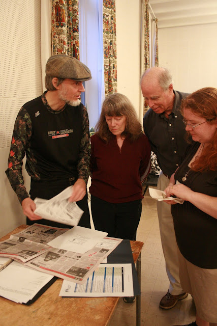 Stairwell Carollers PR committee confers