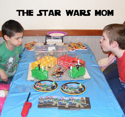 Blowing out the candles on Lego Star Wars cakes.