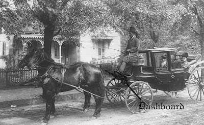 A picture of a fancy old horse-drawn carriage, with the dashboard called out at the driver's feet.