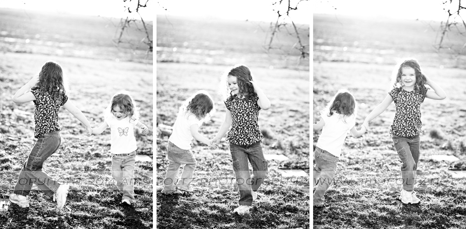 black and white photos of sisters playing  - Terre Haute photographer