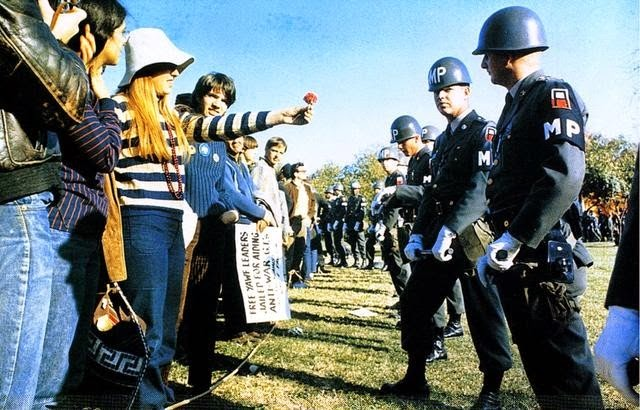 35 moments of violence that brought out incredible human compassion - flower power during the vietnam war protests