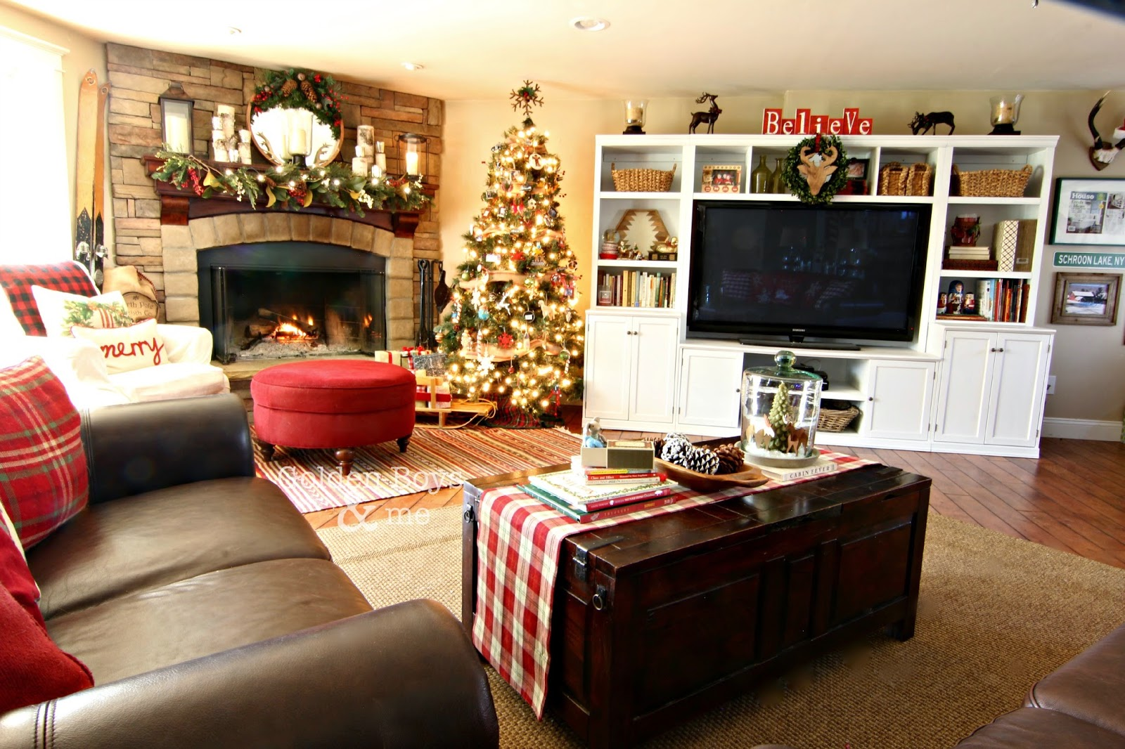 Rustic lodge style family room with Pottery Barn style wall unit with Christmas decor-www.goldenboysandme.com