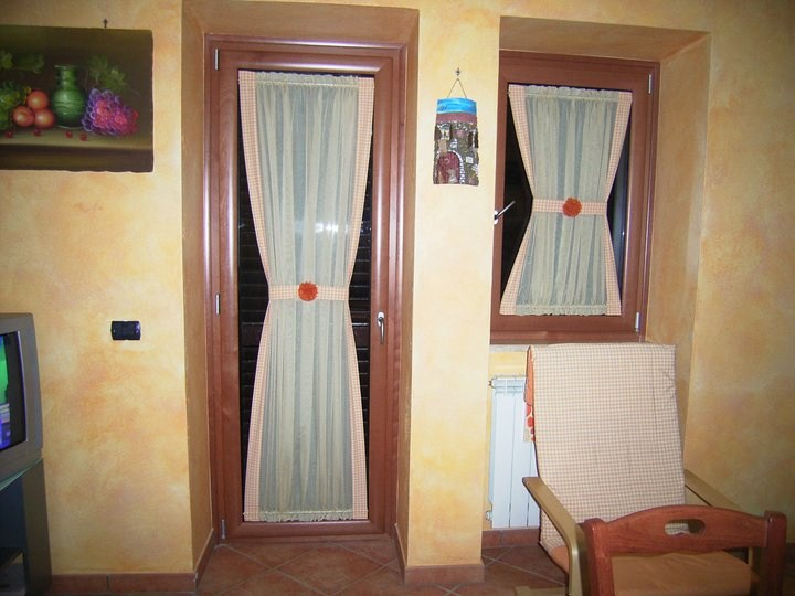 Tendine a vetro tenda zioni - Tende per porta finestra ...