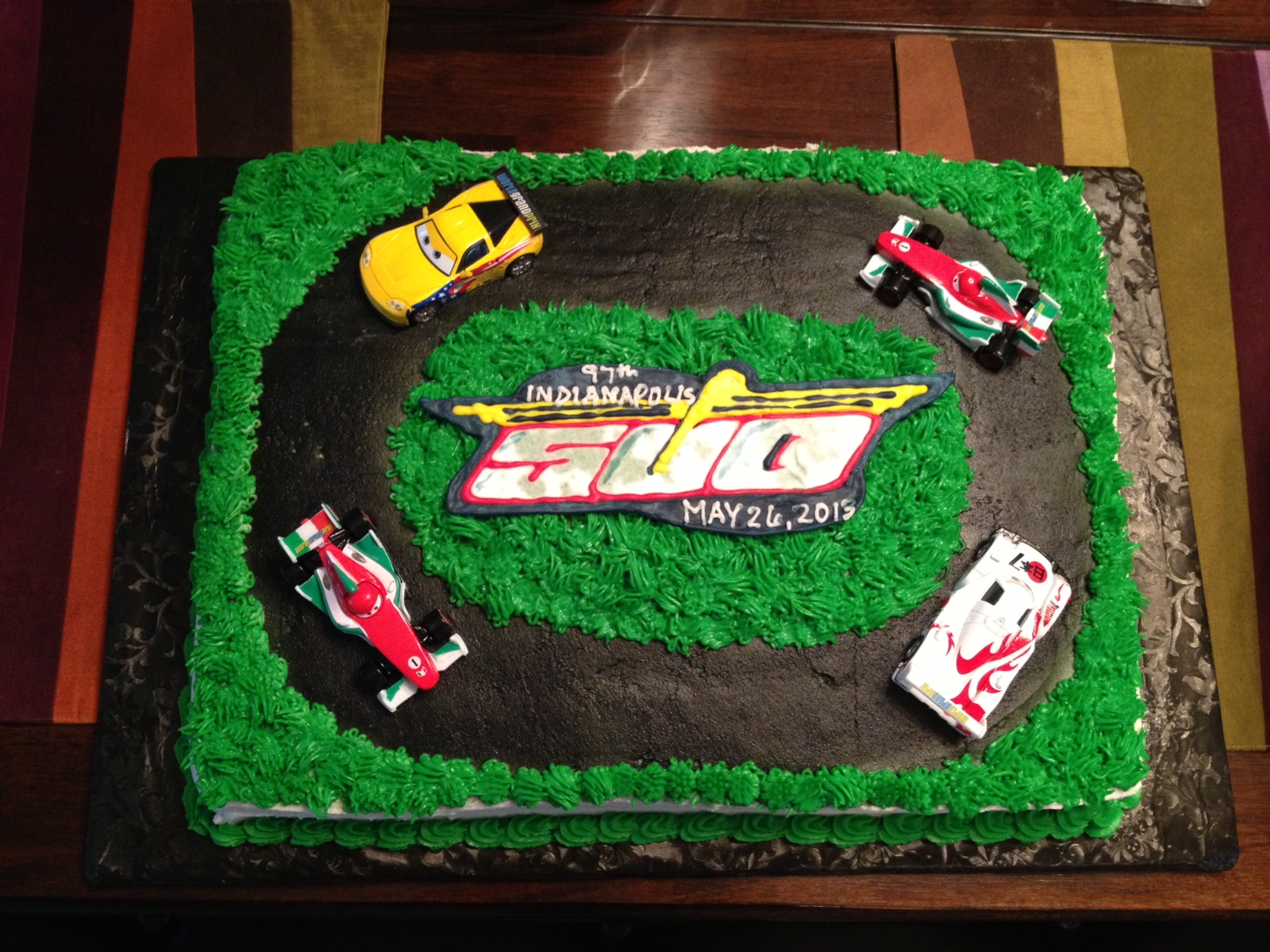 White cake with buttercream frosting. The Indy 500 logo is a colorflow ...