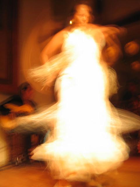 A flamenco dancer in a white dress in madrid spain dancing