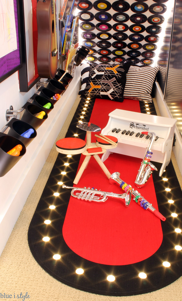 Instruments in rock & roll themed under stair playroom