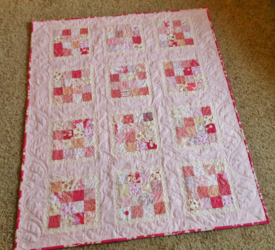 an all pink patchwork baby sized quilt