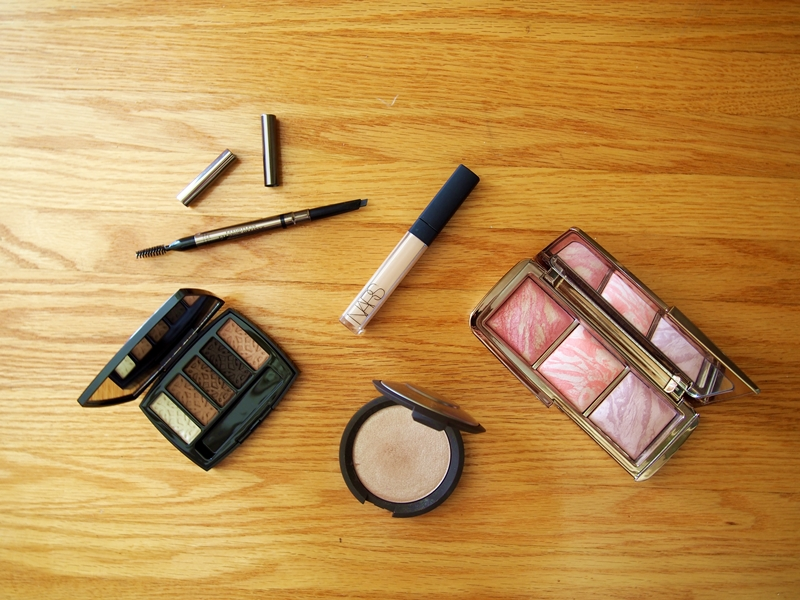 open makeup product flatlay