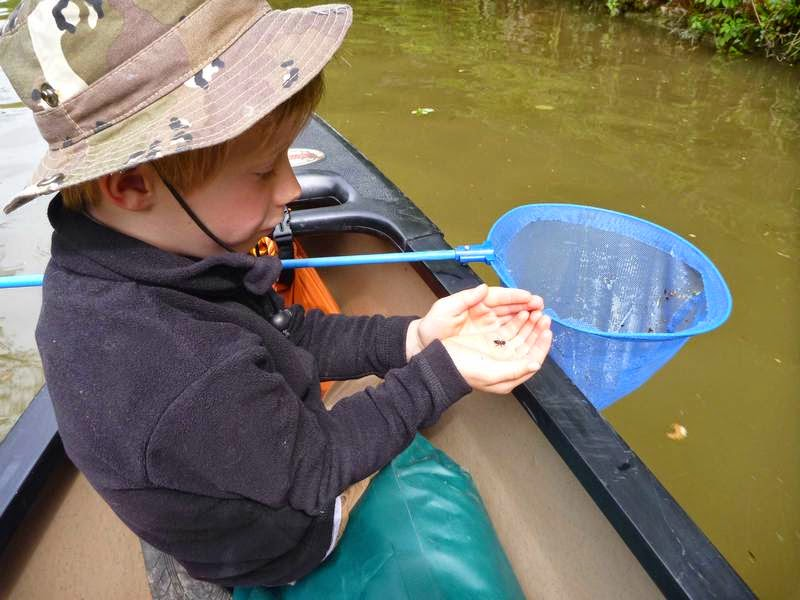 Keeping children busy in a canoe