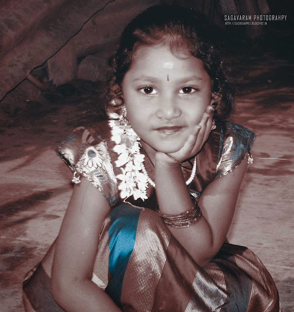 Child in traditional south indian outfit