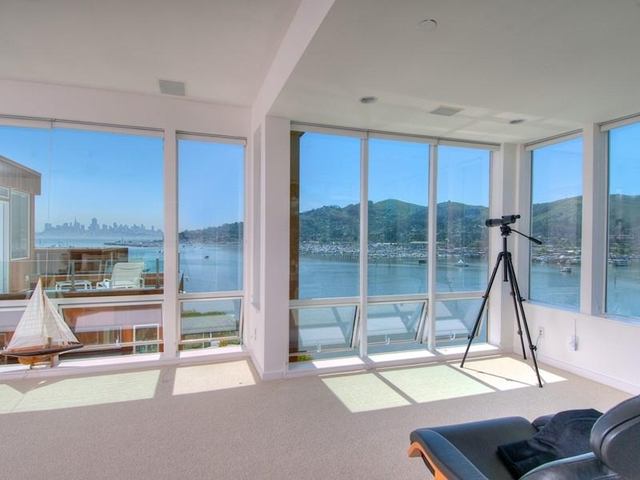 Photo of floor to ceiling windows and the view