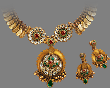 gold kasu mala or kasu necklace studed with kundans and matching gold
