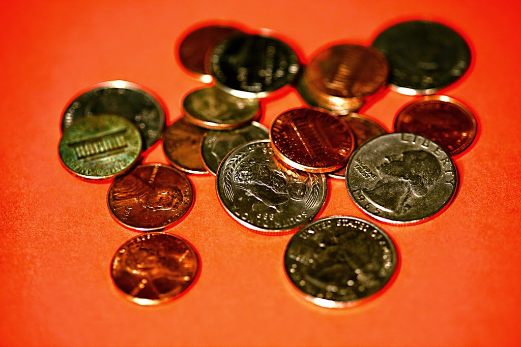 Change by ehpien | picture of various coins. Double Meaning. Change (coins) Change (when things cease being the same).