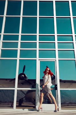 woman running at airport, model near airplane, top fashion photographers nyc