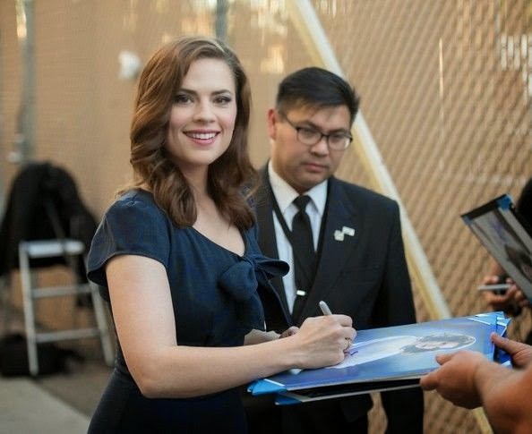 Hayley Atwell was sure to stop and sign some autographs for the patient fans, and she looked stunning while greeting them.