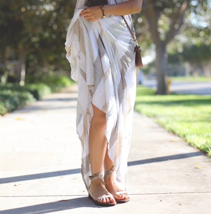 Stephanie Liu of Honey & Silk wearing Ella Moss Aloha dress, Danielle Nicole crossbody, Sseko sandals, Giles & Brother railroad cuff, and Chloe & Isabel leaf bracelet