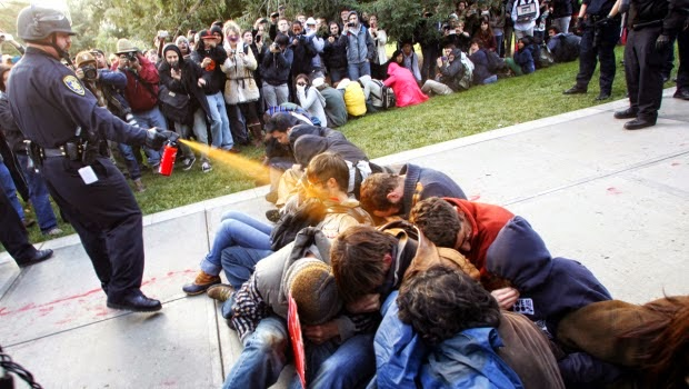 The Cop Who Pepper Sprayed Peaceful Students Will Receive $38,056 for Emotional Suffering
