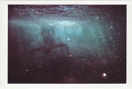 dirty photos - a - dark underwater photo of man upside down