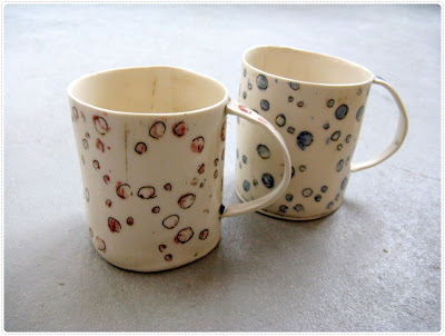 big porcelain hand build mugs with funky blue and red dots