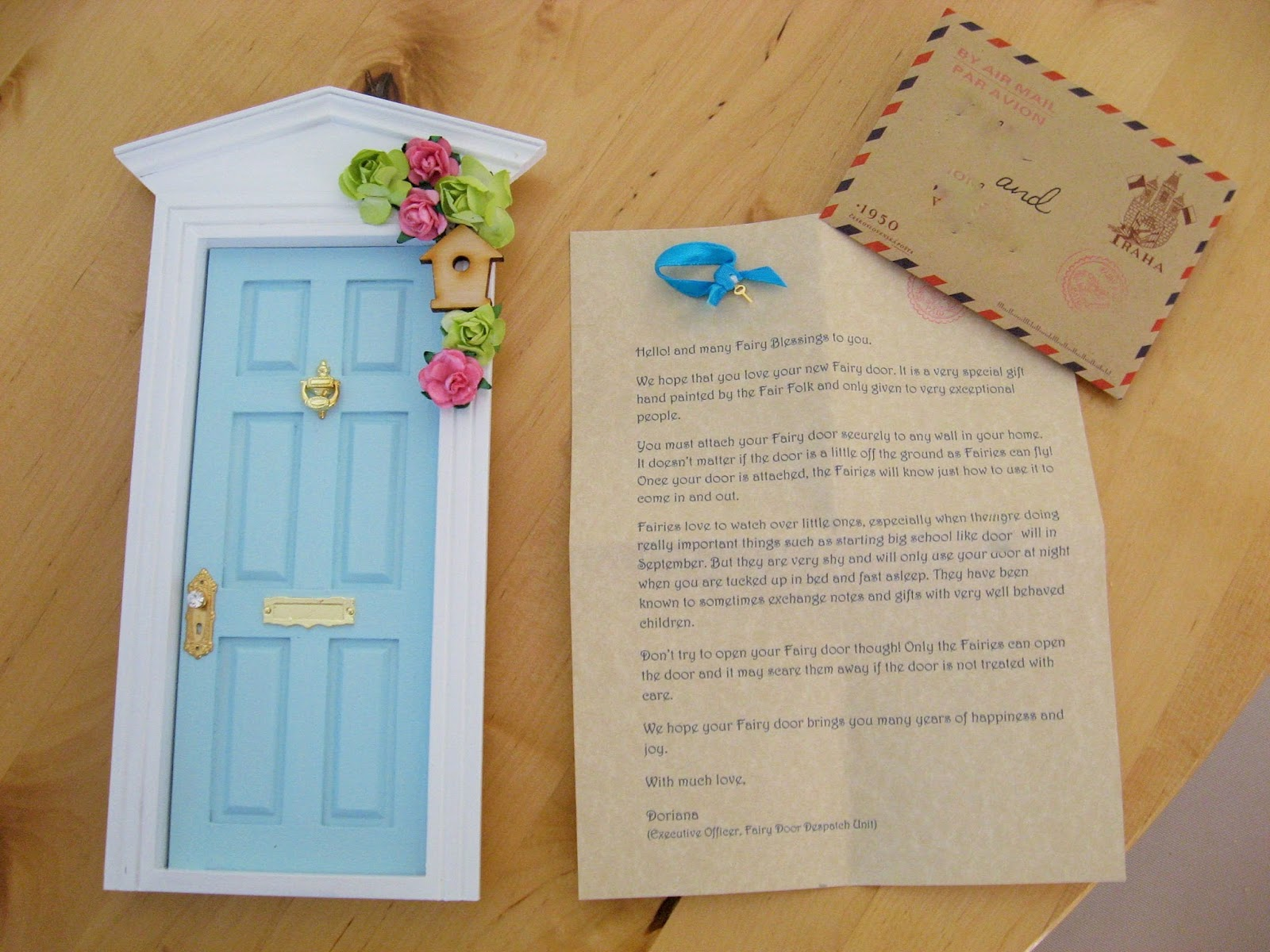 The door arrived carefully packaged with a personalised letter to the girls telling them how to use the door and to take care of it inside the envelope was ... & Loving Life with Little Ones: A gorgeous little fairy door for my girls