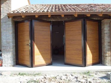 Come costruire la porta di un garage con le perline il for Prezzo per costruire un garage