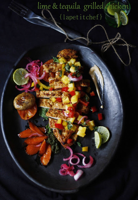 Grilled chicken marinated in a delicious spice rub and tequila, served with a mango salsa and chilli mayonnaise dressing. Its hot, tangy, sweet and spicy all at the same time. This is going to become your favorite chicken dish ever!