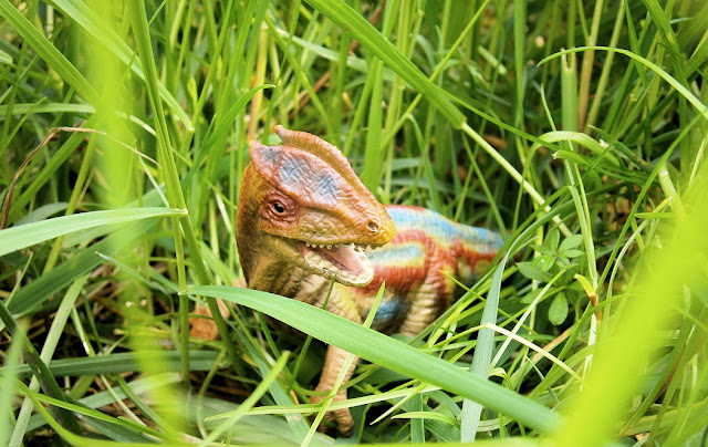 dinosaur in grass realistic toy real