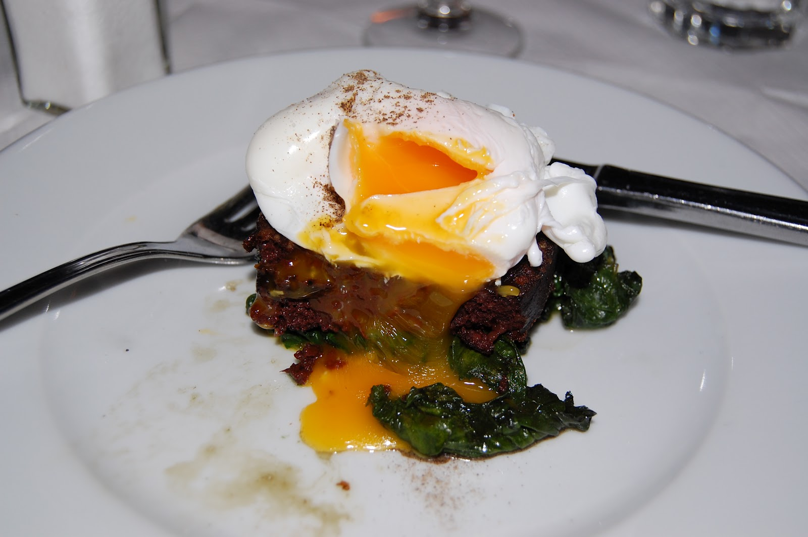 Joe Allen Black Pudding with wilted spinach and poached egg