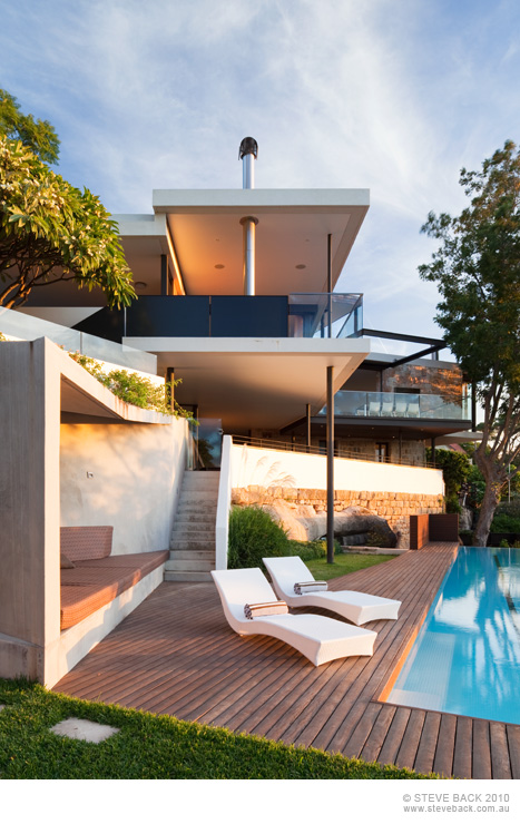 Terrace by the swimming pool of River House by MCK Architects