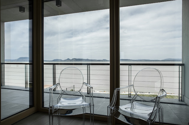 Two glass chairs by the window