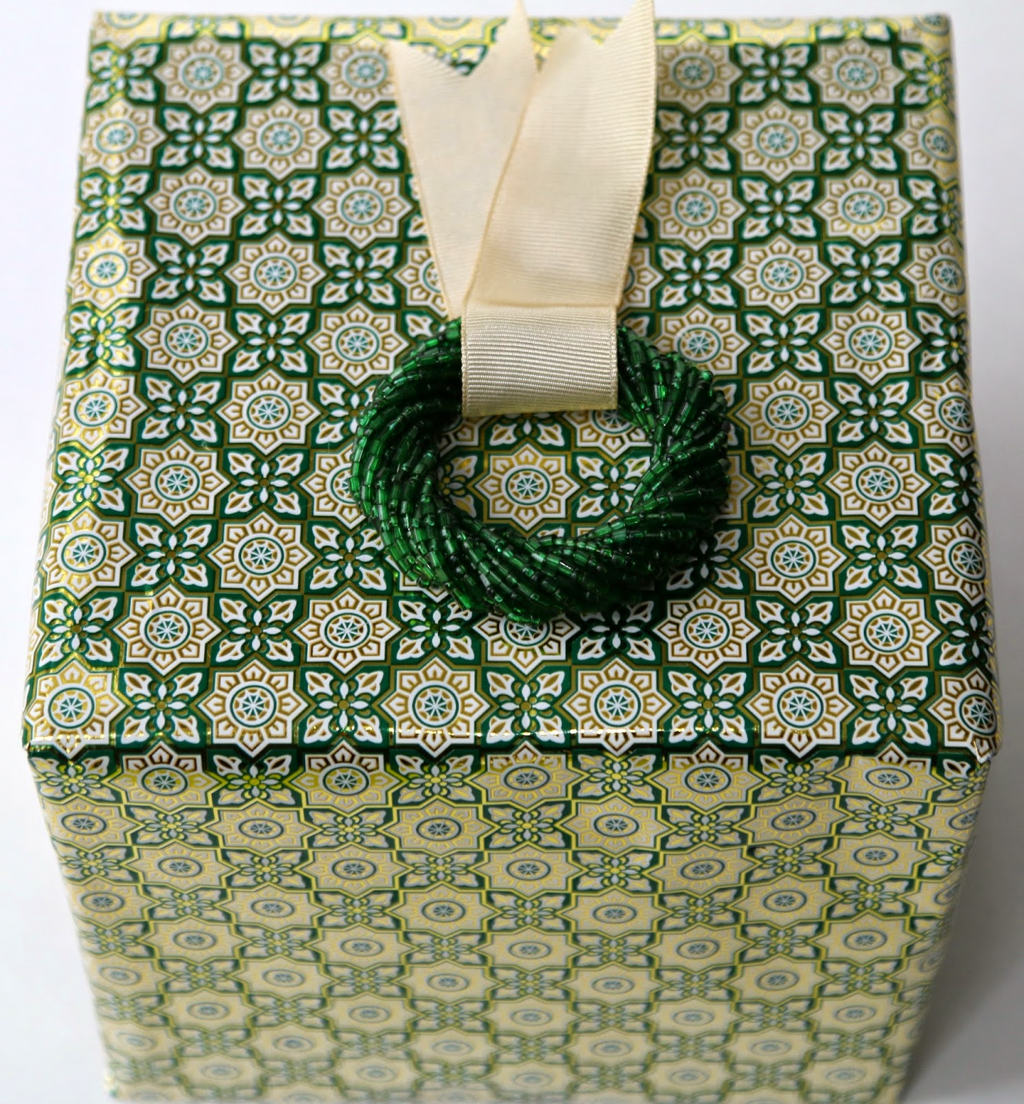 Wrapping with green, gold and holiday ornaments