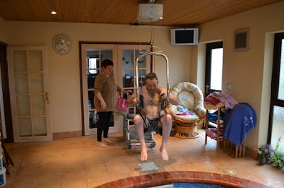 Jason Miller self hoists using the body support system in order to access his swimming pool and hot tub