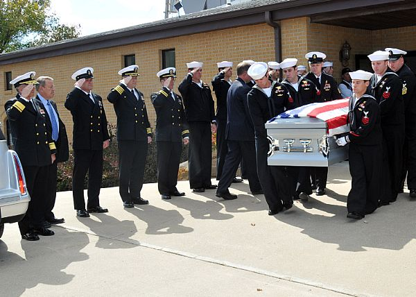 Navy Funeral Uniform Navy seals carry the casket of