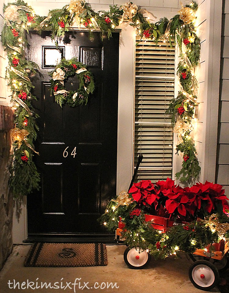 A traditional christmas front porch the kim six fix Outdoor christmas garland ideas