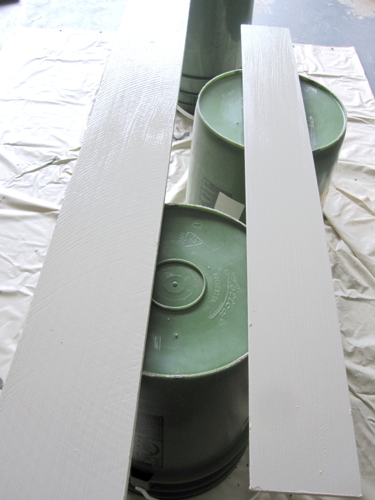 White painted boards on green buckets