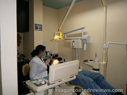 dentist working at the dental chair of Sambitan Dental Clinic