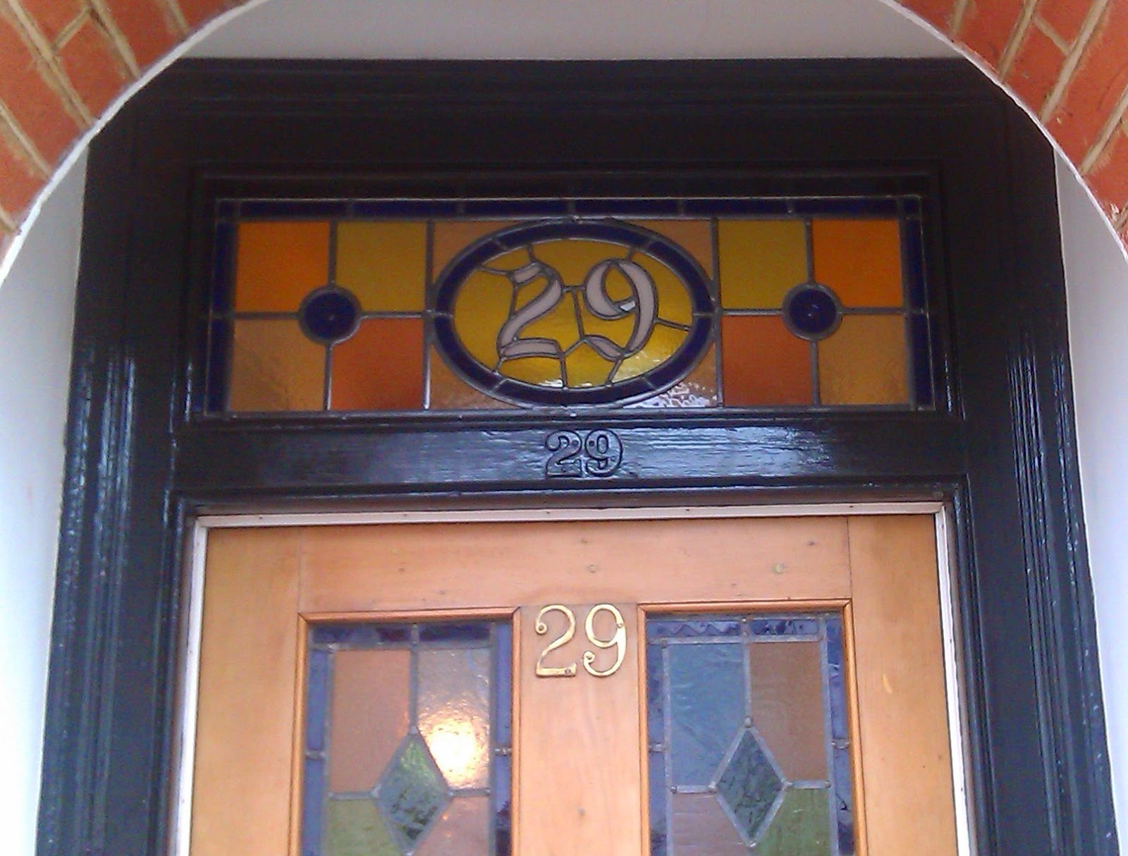 Stained glass house number SW19
