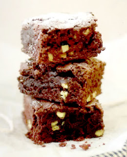 Stach of chocolate brownies dusted with icing sugar