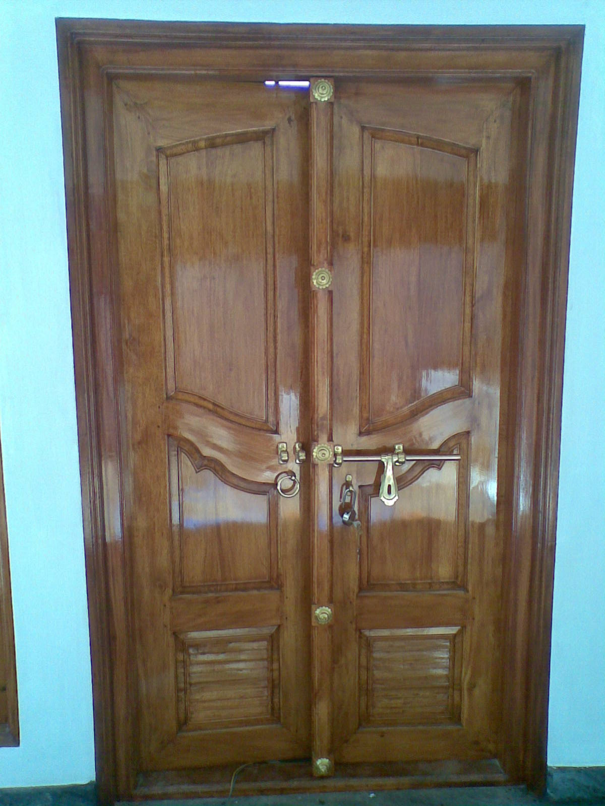 Bavas wood works kerala style wooden front door double for Double door designs for home