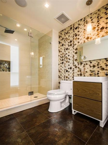 Photo of modern bathroom with dark floor in Philadelphia penthouse