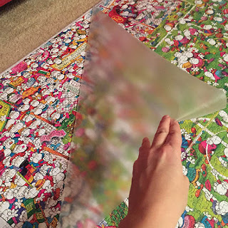 Removing contact paper from the front of a large puzzle