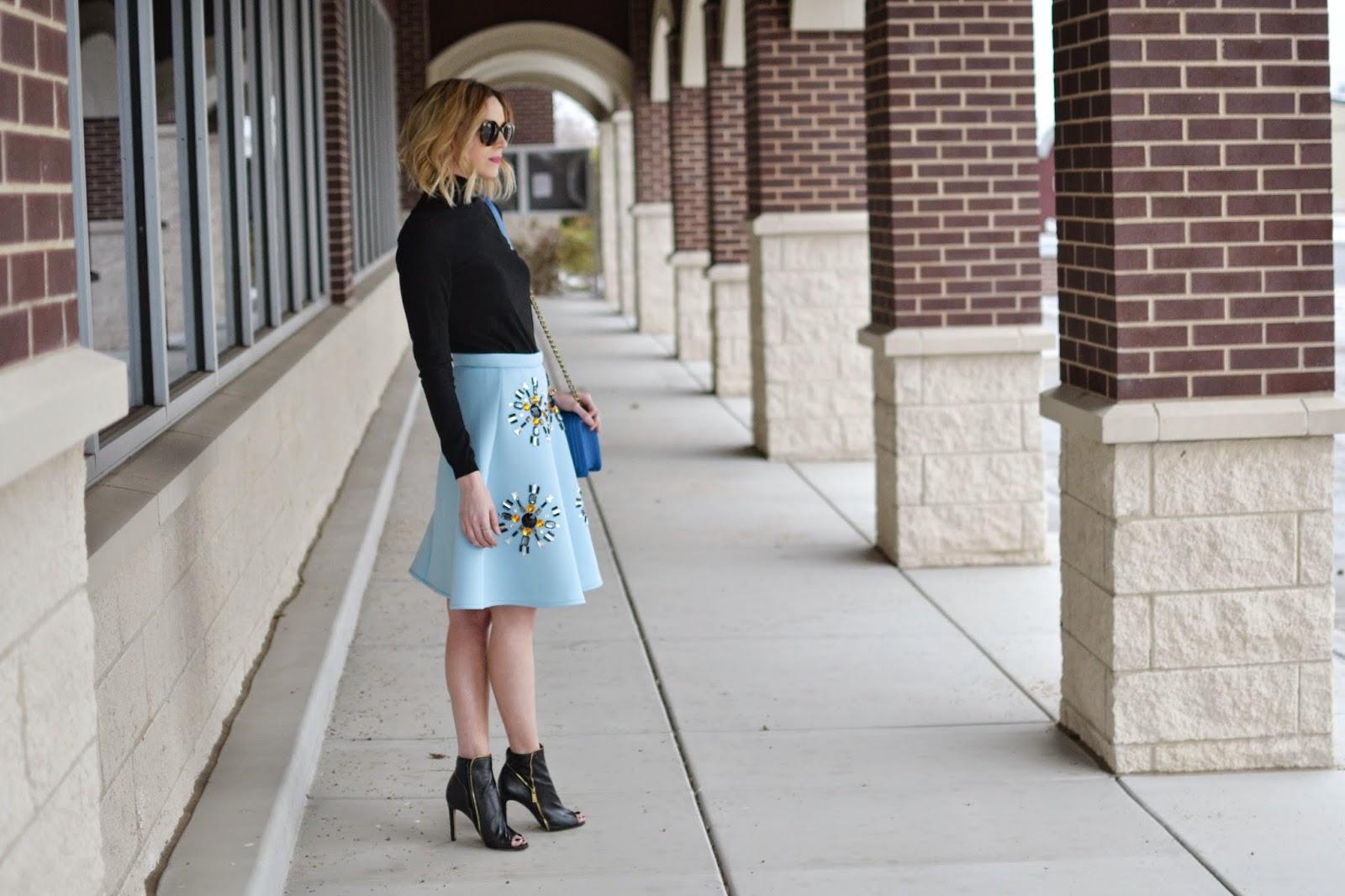 baby blue midi skirt, black turtleneck, black booties, Karen Walker Super Duper Sunglasses, blue purse, Honeybee jewelry