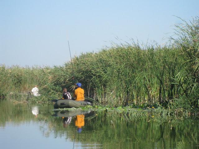 рыбаки в днепровских плавнях