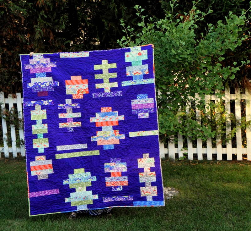 http://quiltyhabit.blogspot.com/2014/07/midsummer-finished-quilt.html