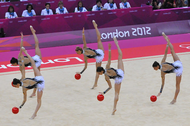 In the group competition, there are five members on each team. In the
