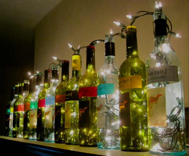 Wine bottle lights the surznick common room for Empty bottle decoration ideas
