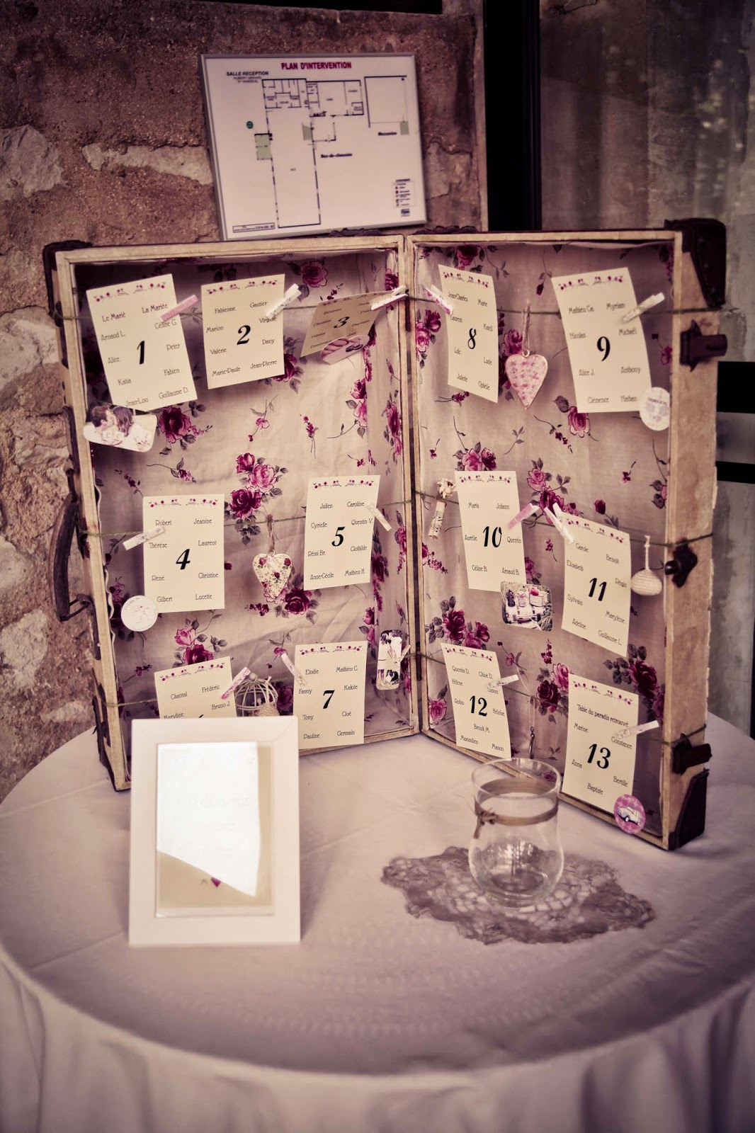 Wedding table plan cards in vintage suitcase - wedding sweet table - wedding photography by Elisabeth Perotin